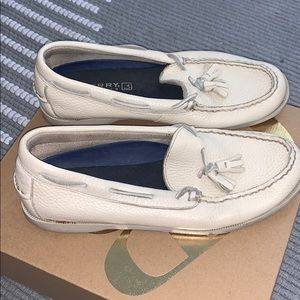Tan leather sperry shoes